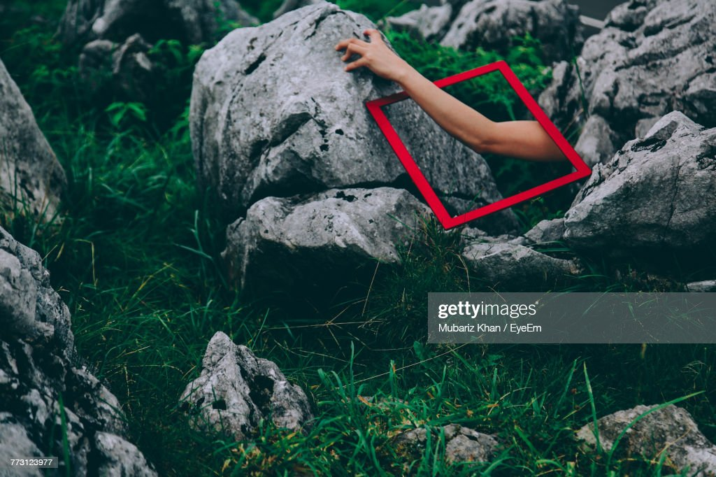 Cropped Hand On Woman On Rock : Photo