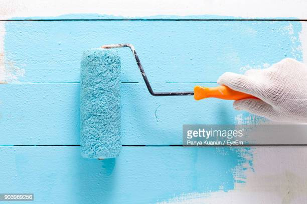 cropped hand painting wall - paint roller stock pictures, royalty-free photos & images