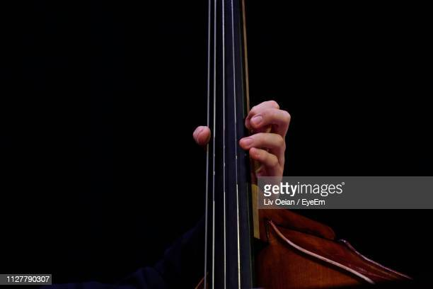 cropped hand playing cello - musical instrument string stock pictures, royalty-free photos & images