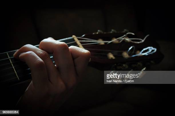 Cropped Hand Playing Guitar