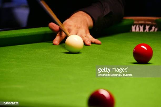 cropped hand playing pool - snooker stock pictures, royalty-free photos & images