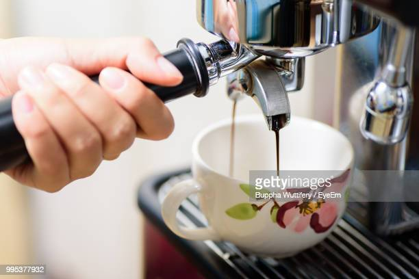 Cropped Hand Preparing Drink With Coffee Maker