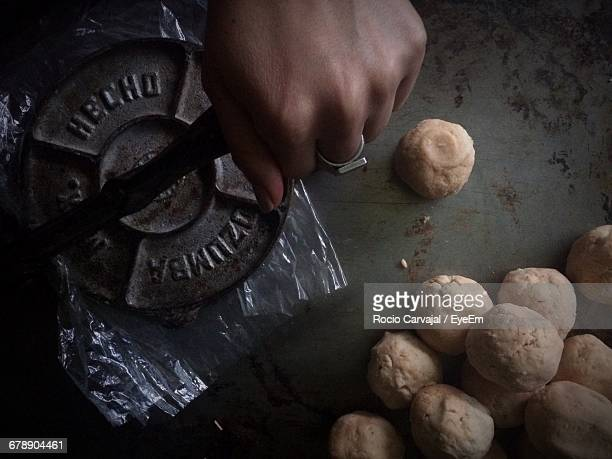 cropped hand preparing food with tortilla press on table - carvajal ストックフォトと画像