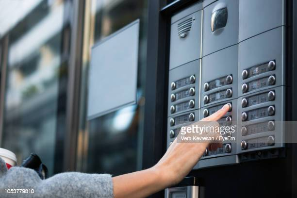 Cropped Hand Pressing Button In Building