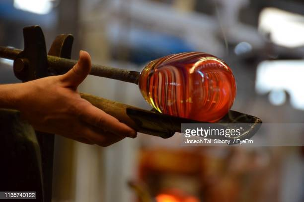 cropped hand sculpting molten glass - sculptor stock pictures, royalty-free photos & images
