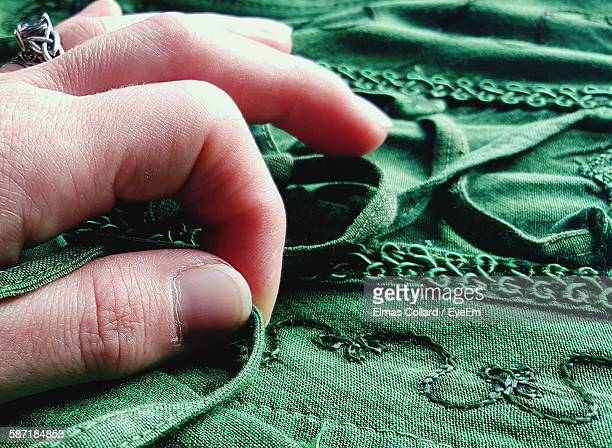 Cropped Hand Touching Fabric