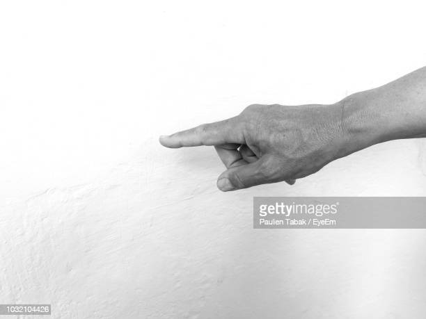 cropped hand touching wall - paulien tabak stock pictures, royalty-free photos & images