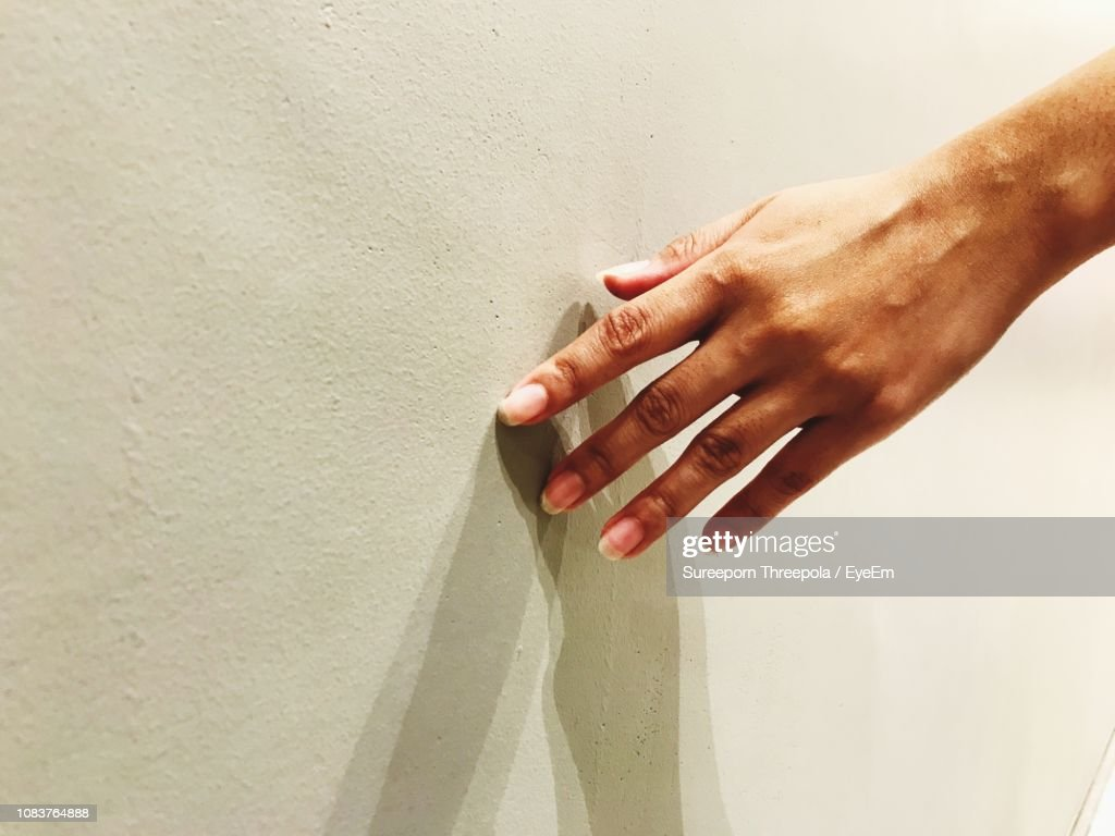 Cropped Hand Touching Wall : Stock Photo