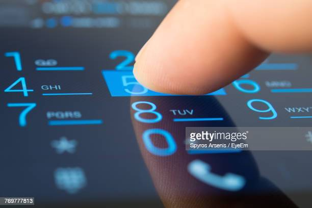 cropped hand using mobile phone - dialing stock pictures, royalty-free photos & images