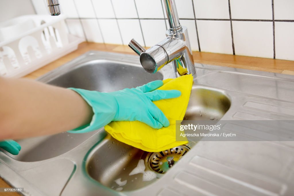 Cropped Hand Wearing Protective Glove While Cleaning Kitchen Sink : Stock Photo