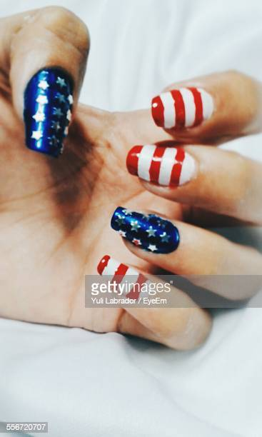 Cropped Hand With American Nail Polish