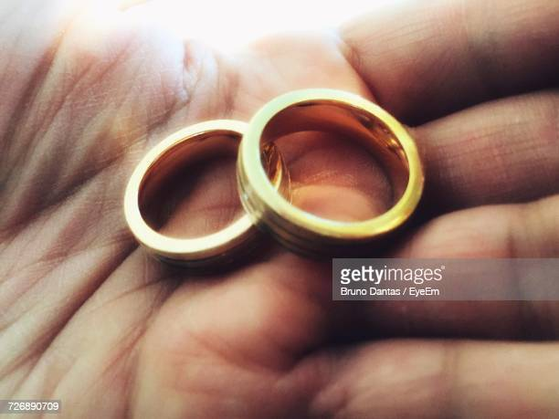 Cropped Hand With Gold Wedding Rings