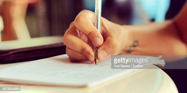 Cropped Hand Writing In Book