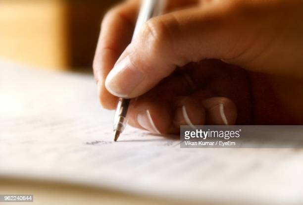 cropped hand writing on paper - writing stock pictures, royalty-free photos & images