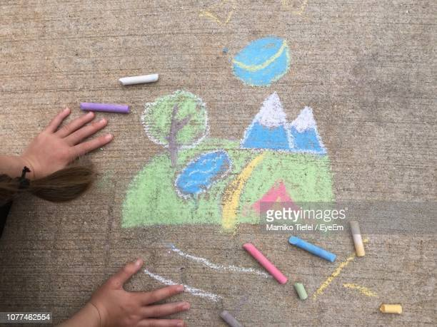 cropped hands by drawing on footpath - chalk art equipment stock pictures, royalty-free photos & images