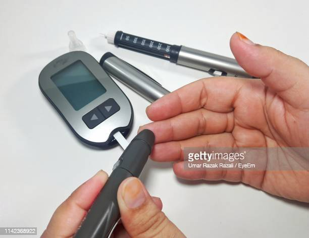 Cropped Hands Checking Blood Sugar
