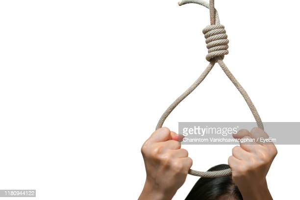 cropped hands committing suicide with noose against white background - suicide stock pictures, royalty-free photos & images