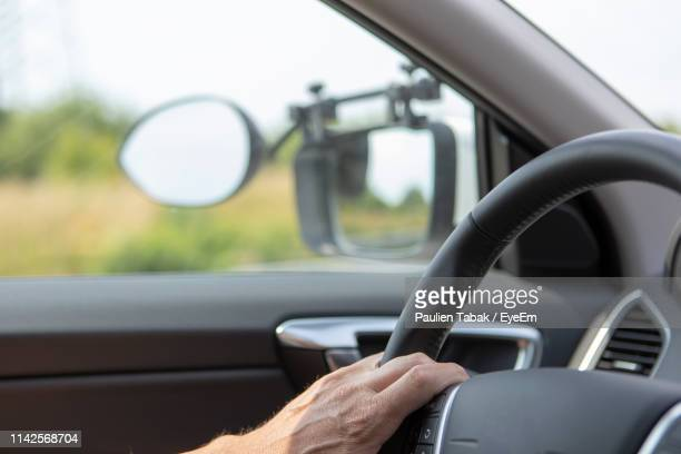 Cropped Hands Driving Car