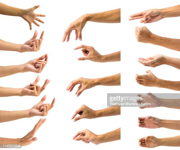 cropped hands gesturing against white background - esprimere a gesti foto e immagini stock