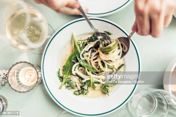 cropped hands having pasta on table - ready to eat stock pictures, royalty-free photos & images