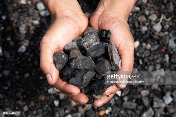 Cropped Hands Holding Coals