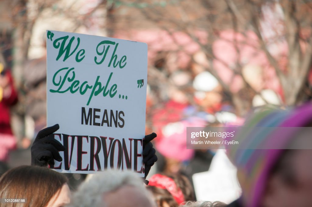 Cropped Hands Holding Placard With Text During Protest In City : Stock Photo