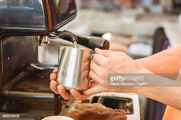 Cropped Hands Making Coffee In Cafe
