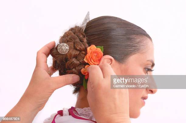 Cropped Hands Making Hairstyle Of Bride Against White Background