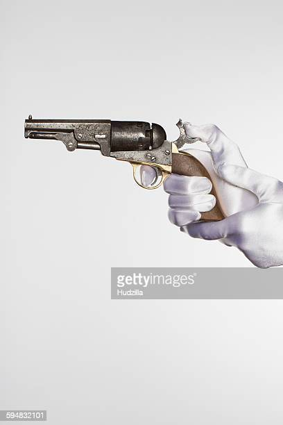 cropped hands of bride holding handgun against white background - trigger stock pictures, royalty-free photos & images