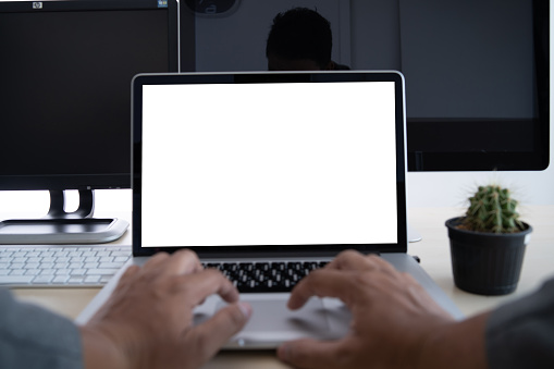 Cropped Hands Of Businessman Using Laptop While Working In Office - gettyimageskorea