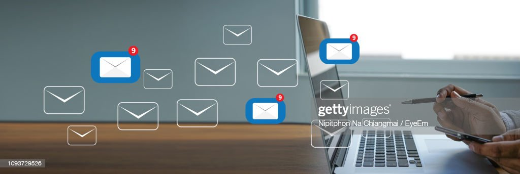 Cropped Hands Of Businessman Using Phone And Laptop In Office : Stock Photo