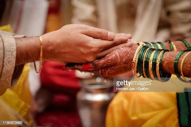 cropped hands of couple during wedding ceremony - ceremony stock pictures, royalty-free photos & images
