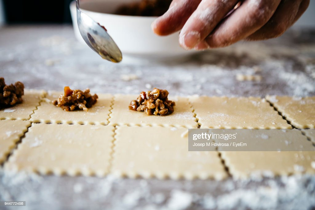 Cropped Hands Of Male Chef Preparing Food On Table : Stock Photo
