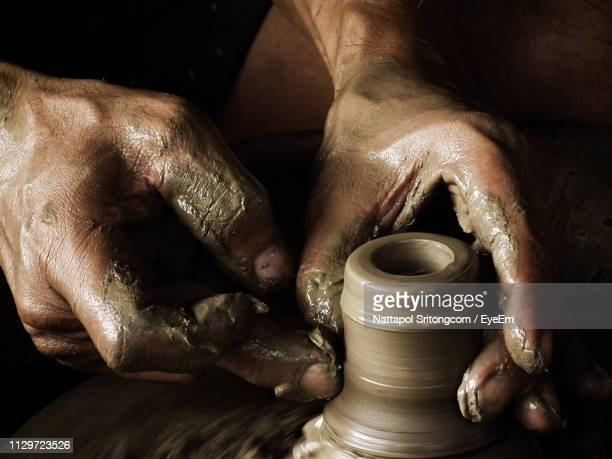 cropped hands of man making pot in workshop - pottery stock pictures, royalty-free photos & images
