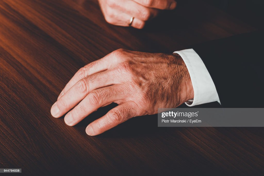 Cropped Hands Of Man On Table : Stock Photo