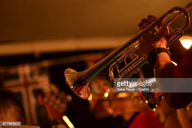 cropped hands of man playing saxophone - jazz stock pictures, royalty-free photos & images
