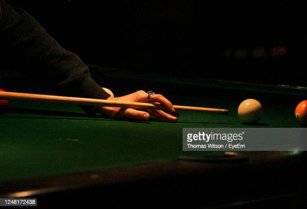 cropped hands of man playing with snooker on table - championship stock pictures, royalty-free photos & images