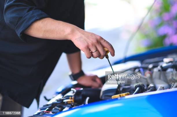 cropped hands of mechanic maintain car, engine oil check and replace - motor oil stock pictures, royalty-free photos & images