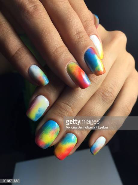 cropped hands of mid adult woman with colorful nail polish - nail art stock pictures, royalty-free photos & images
