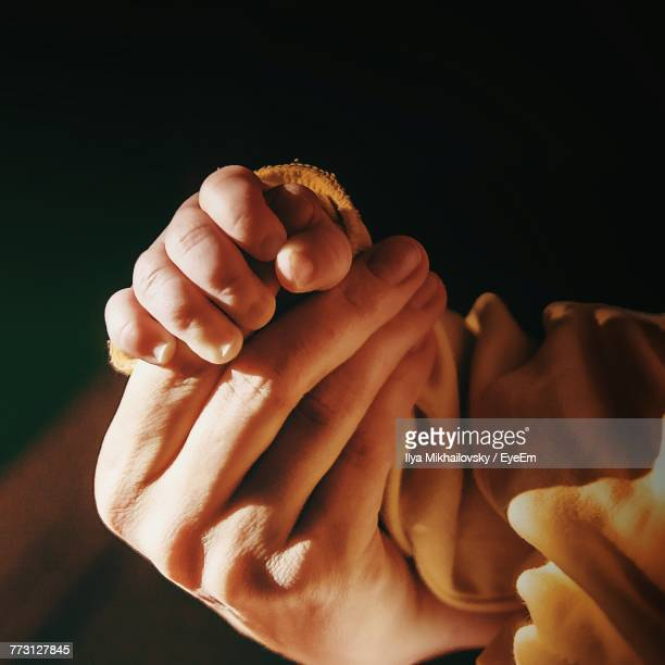 Cropped Hands Of Mother And Baby