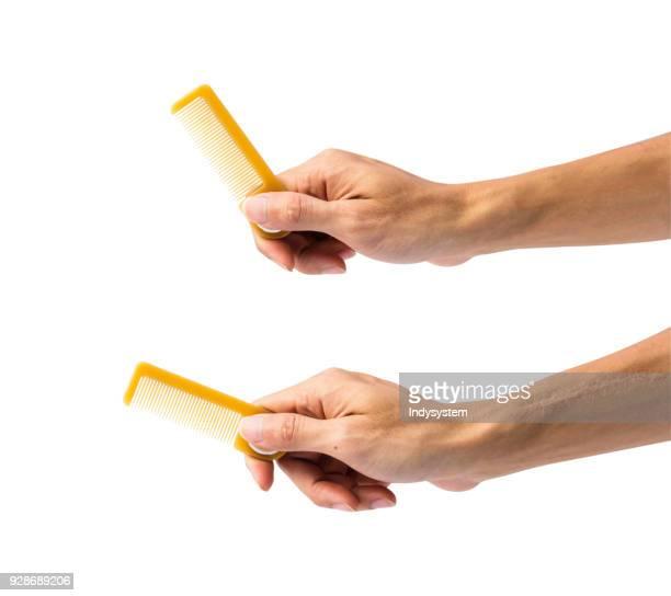 cropped hands of people holding combs against white background - penteando imagens e fotografias de stock