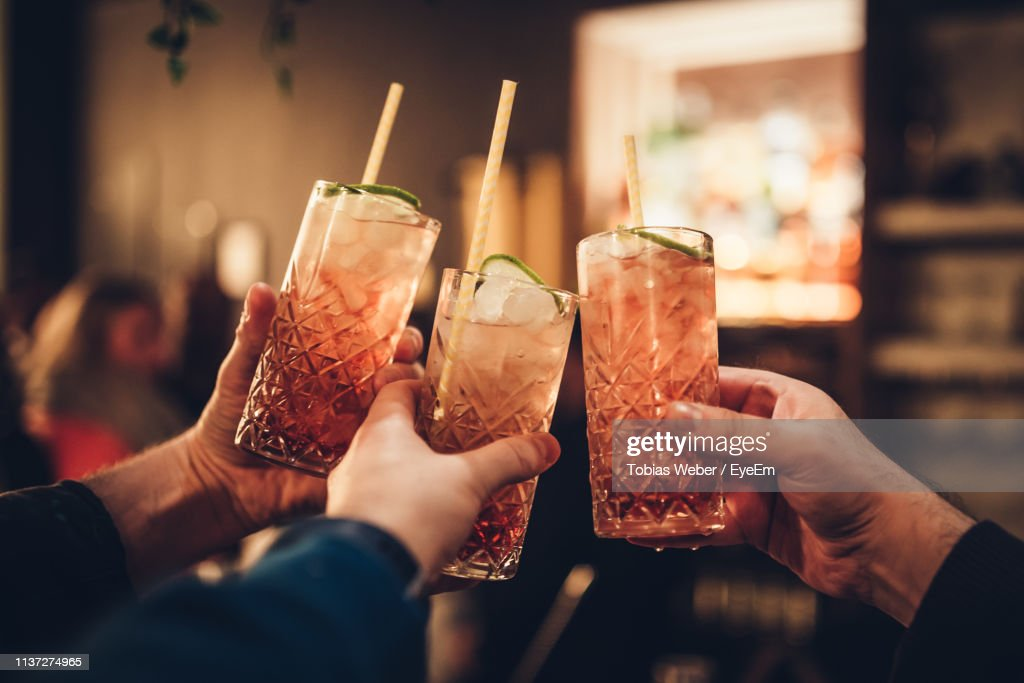Cropped Hands Of People Holding Drinks : Stock Photo