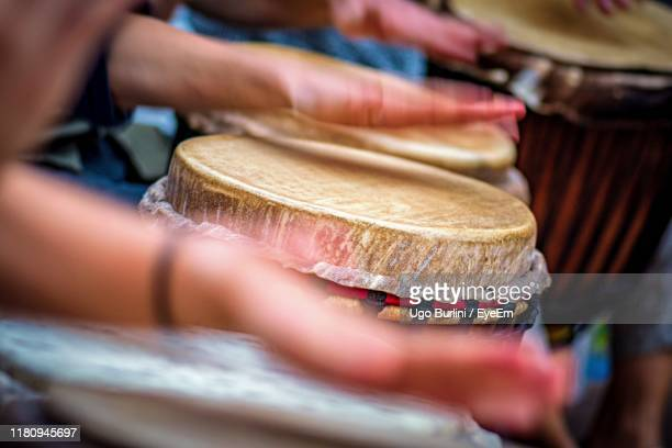 cropped hands of people playing drums - percussion instrument stock pictures, royalty-free photos & images