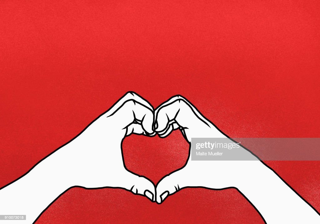 Cropped hands of person making heart shape against red background : Stock-Foto