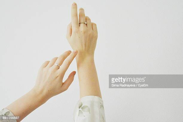 Cropped Hands Of Woman Against White Background