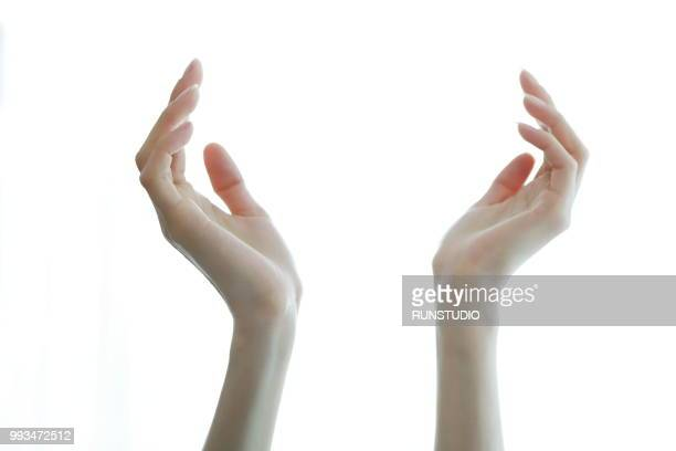 cropped hands of woman gesturing against white background - beautiful bare women stock pictures, royalty-free photos & images