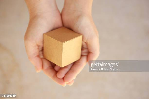 Cropped Hands Of Woman Holding Toy Block