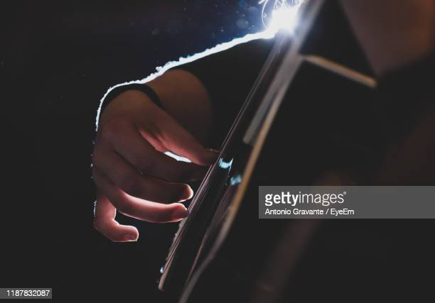 cropped hands of woman playing guitar - guitarist stock pictures, royalty-free photos & images