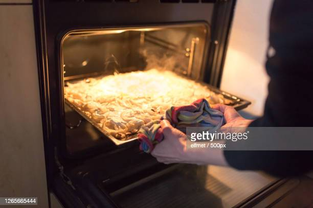 cropped hands of woman preparing food in kitchen, erfurt, germany - einkaufen stock pictures, royalty-free photos & images