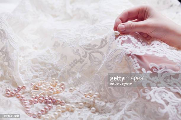cropped hands of woman stitching wedding dress - needlecraft stock pictures, royalty-free photos & images